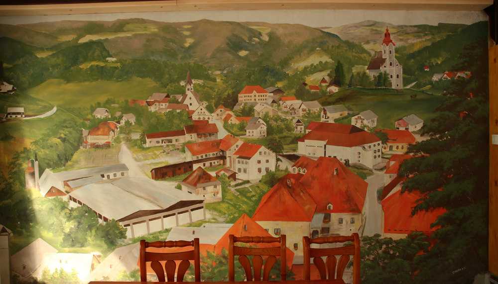 Painting the central pub of Vitanje, the monolithic building of KSEVT is not included, we started from there to understand what was its influence in popular and local culture