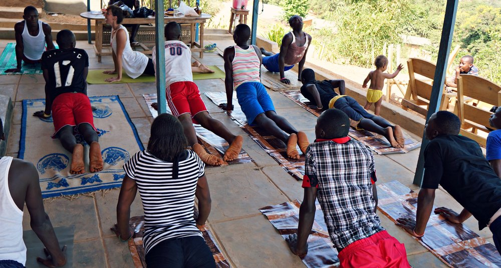 Guiding_upward_facing_dog_Sierra_leone_yoga_project.jpg