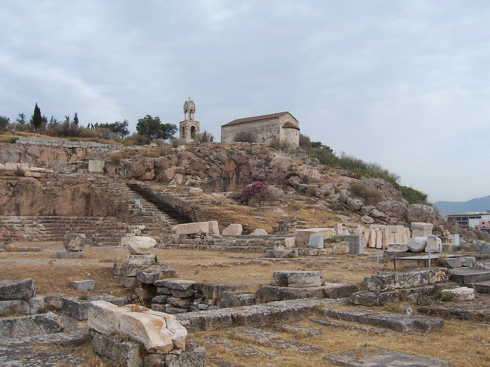 image: the ruins of the sanctuary at Eleusis, including the Telesterion. Wikimedia commons (link).