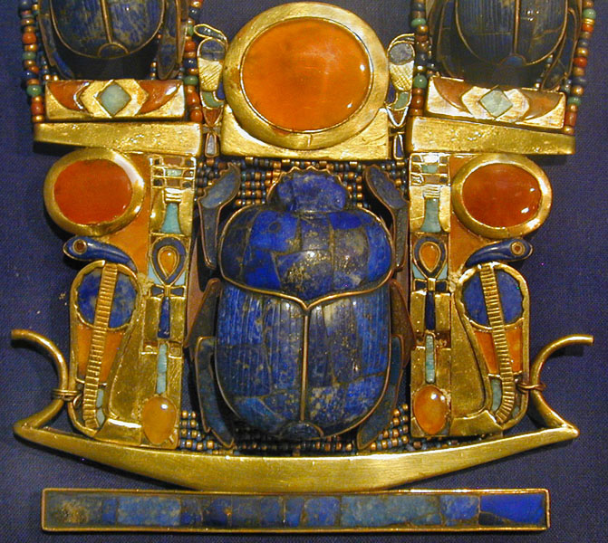 image: detail from necklace found in the tomb of Tutankhamun, Wikimedia commons (link).