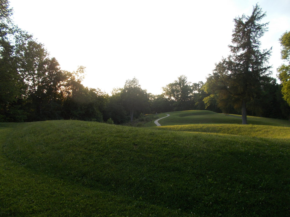 "image: looking downhill towards the head of Great Serpent Mound, from the outside edge of the second full ""closed-to-the-east"" hairpin curve in the body of the Serpent (the middle of three such ""closed-to-the-east"" curves), 06/17/2017."