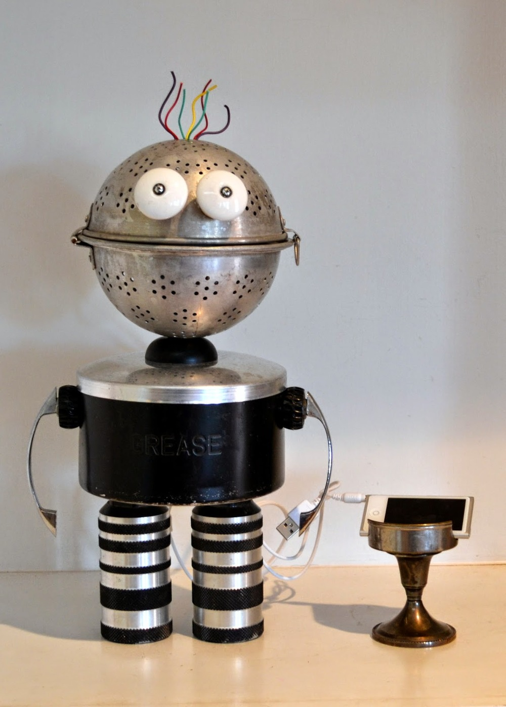 https://www.etsy.com/listing/225889731/dj-bot-a-recycled-robot-and-ipod-player?ref=shop_home_active_1