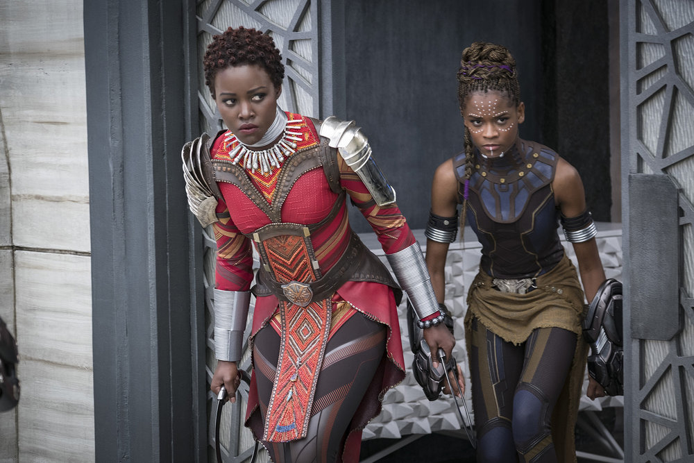 "Nakia (Lupita Nyong'o), left, and Shuri (Letitia Wright). ""Black Panther"" follows conventions of action movies but also enlarges and revitalizes them. MUST CREDIT: Matt Kennedy, Marvel Studios-Walt Disney"