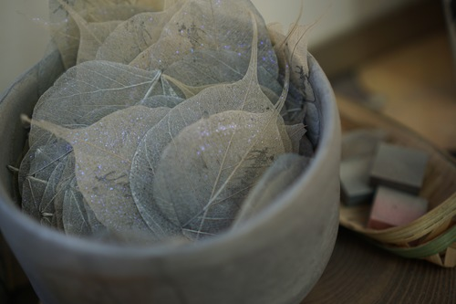 "Miya's ""business cards"" are printed on leaves that have been found outside and treated with her special secret process."