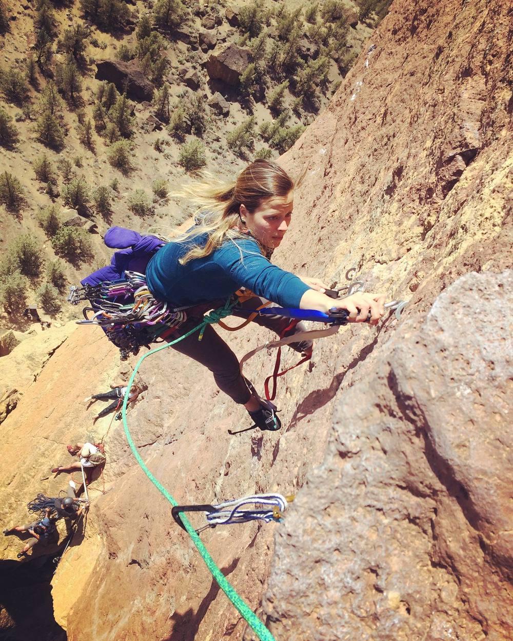 Mackenzie burls up the aid ladder on Monkey Face (5.8), Smith Rock, Oregon