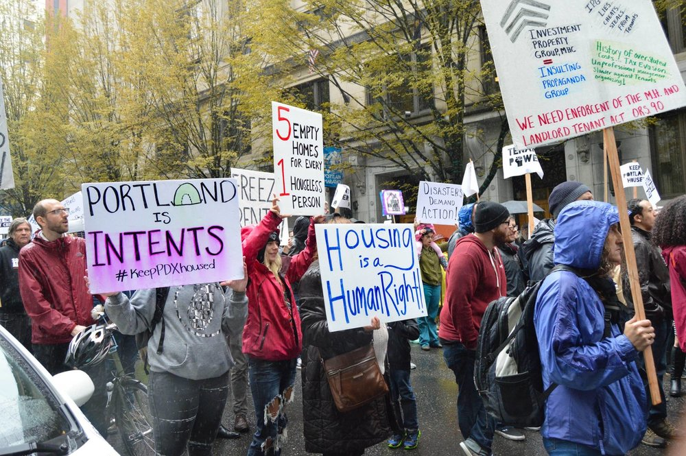 """There are five empty homes for every one houseless person."" This was a rally and march for a rent freeze organized by Portland Tenants United. Photo courtesy of Kathryn Stevens."
