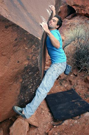 Andrew Bisharat pooping on a boulder. Photo courtesy of google search and Rock and Ice.