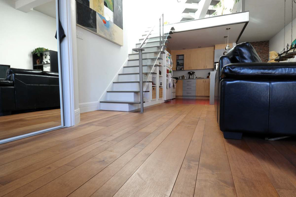 maple hardwood plank floor stained.jpg