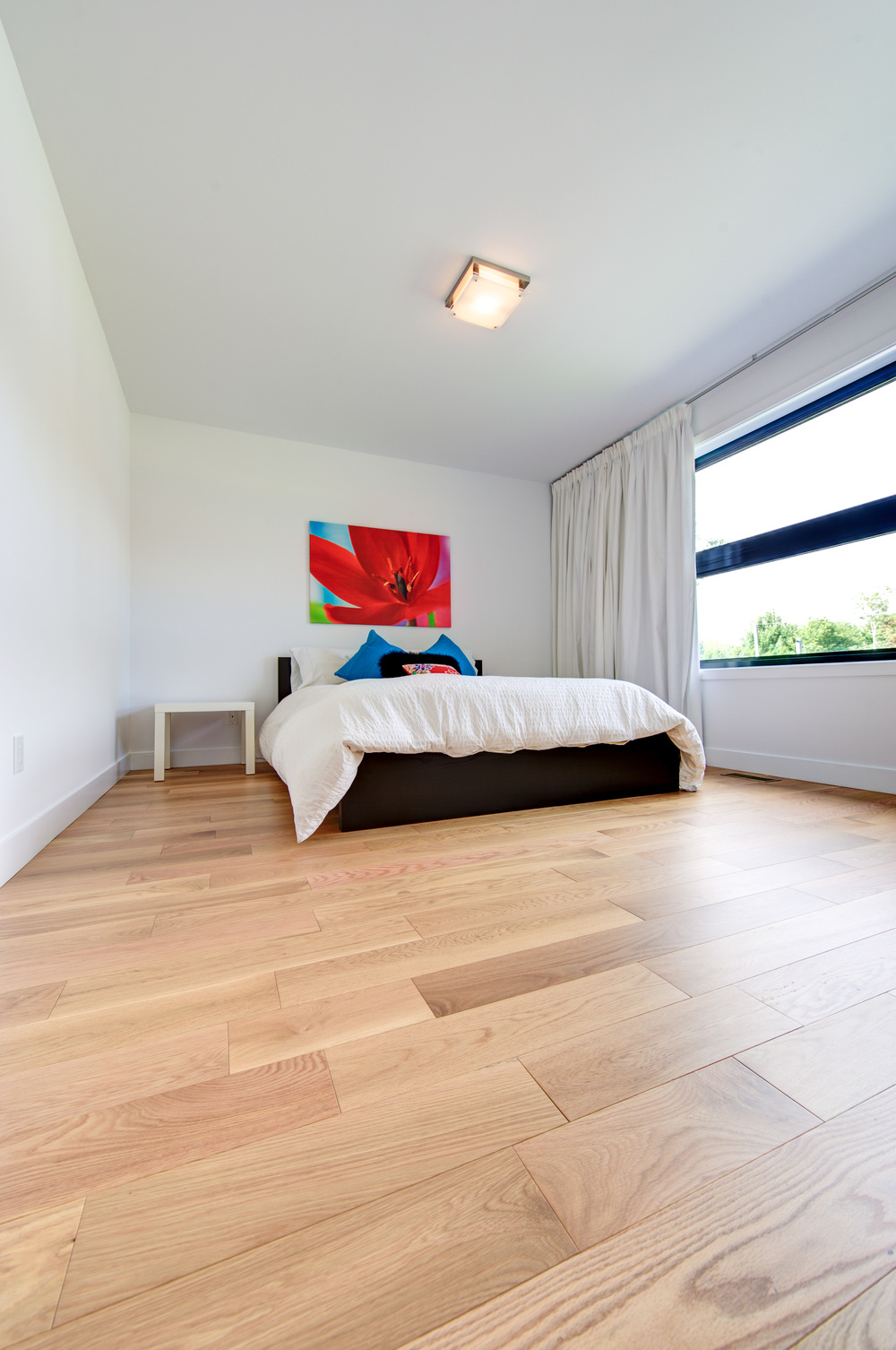 wide plank red oak floor bedroom.jpg