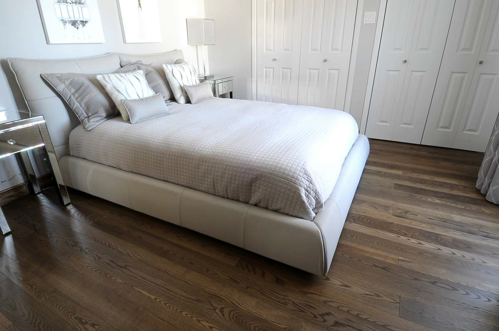 stained ash bedroom hardwood flooring.jpg