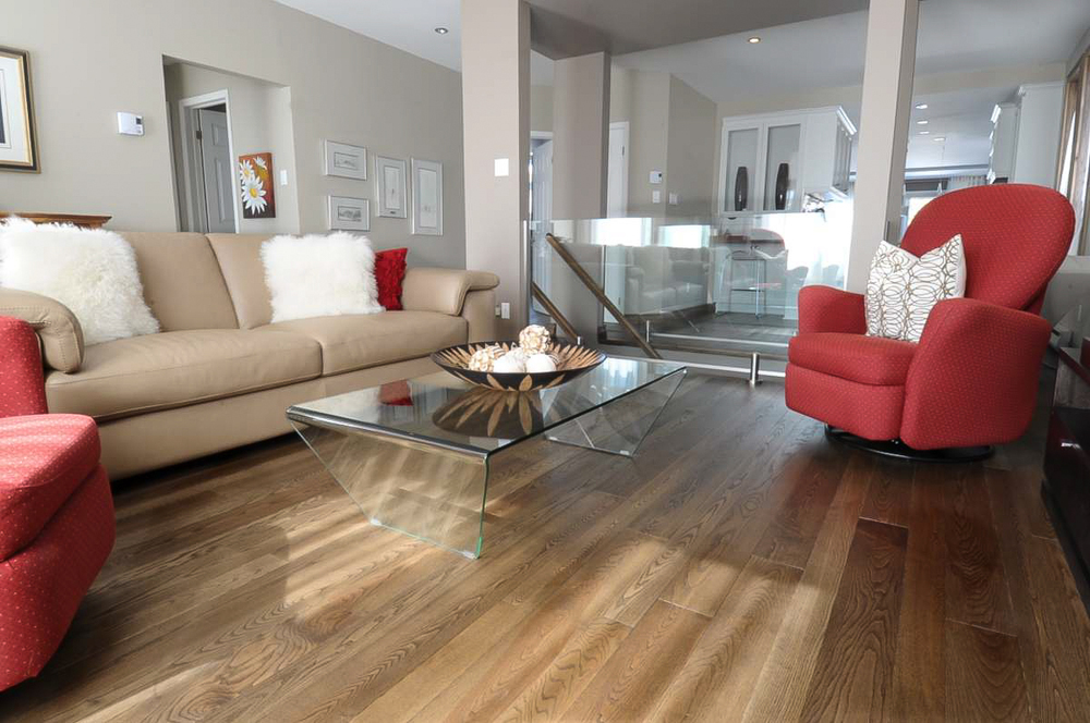 stained ash living room hardwood flooring.jpg