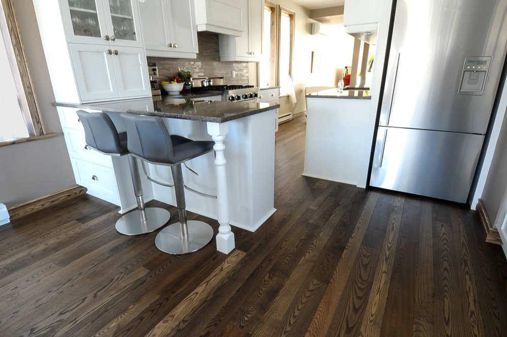 stained ash kitchen hardwood flooring.jpg