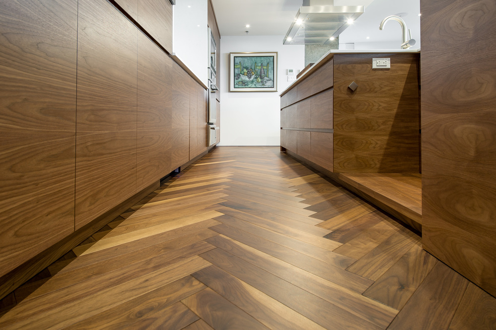 black walnut herringbone kitchen wood flooring.jpg