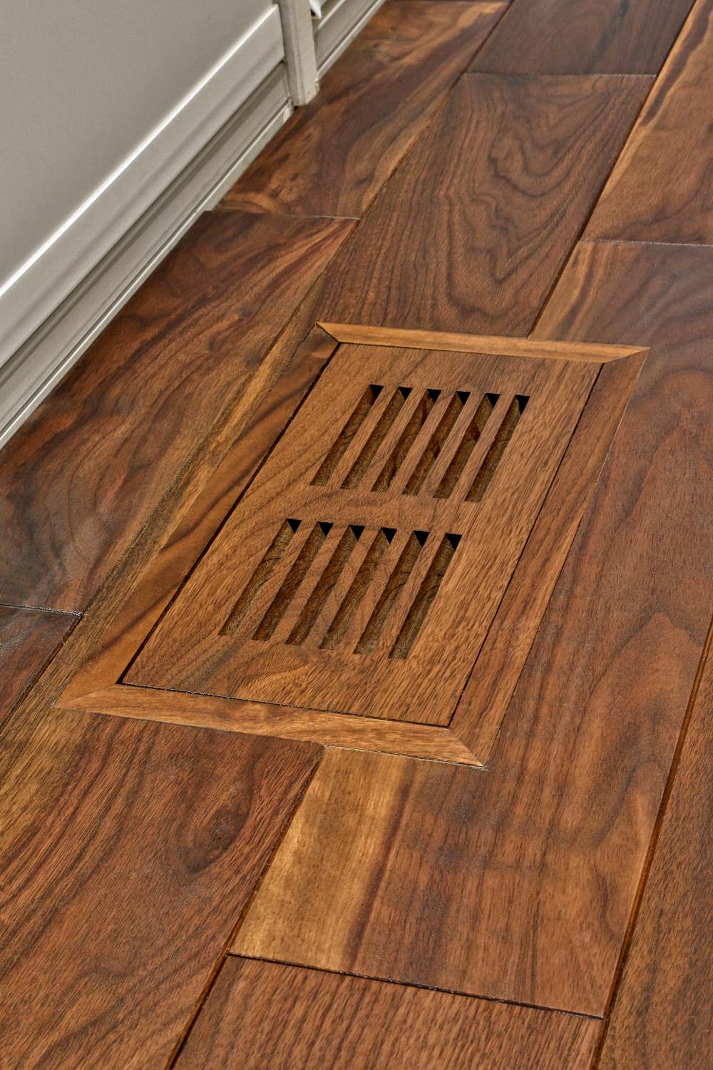 walnut flooring heating vent detail.jpg