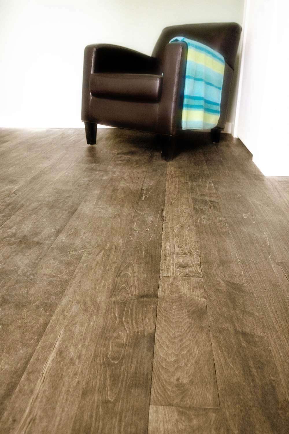 stained birch wide plank floor.jpg