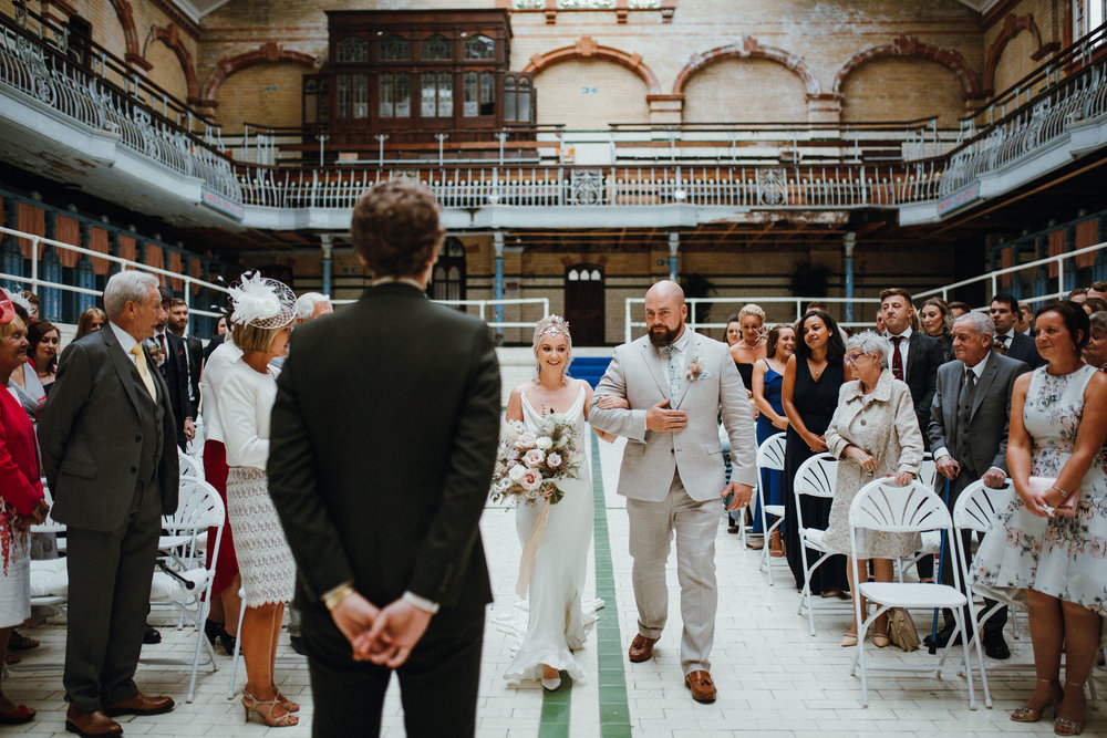 Bride walking up the aisle at Victoria Baths