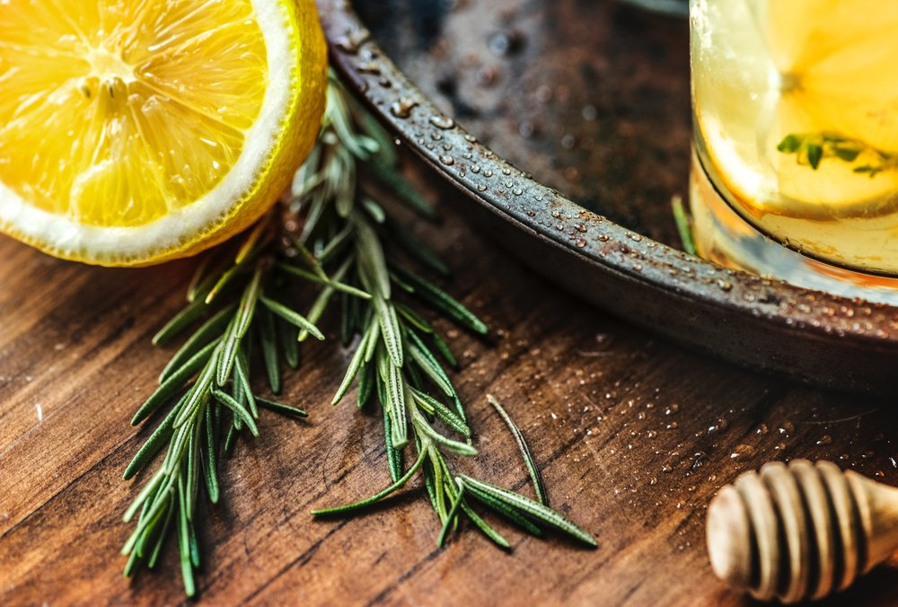 Lemons and rosemary on a rustic wooden table