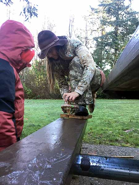 Making friction fire with a bow-drill