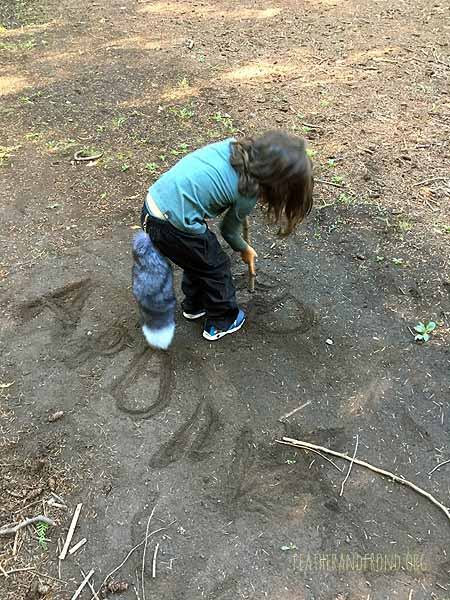 Writing our names in the dirt