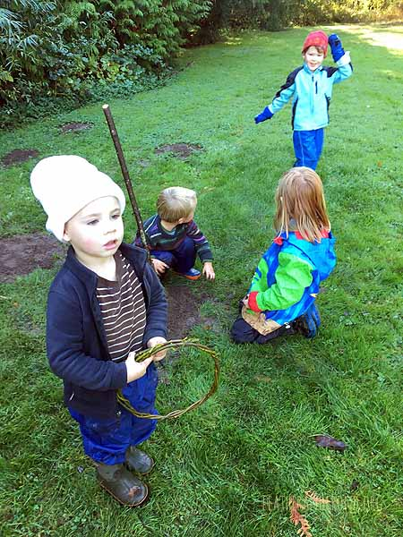 Playing a hoop and stick game