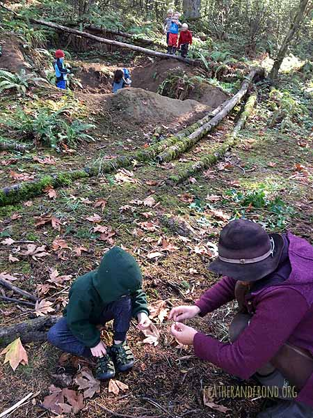 Working on Nettle cordage at Falcon's Nest