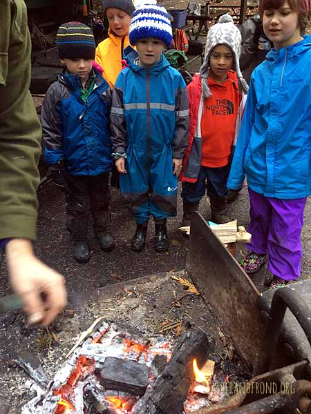 Making char-cloth in the fire!
