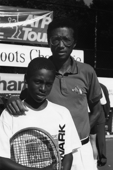Arthur Ashe with a student