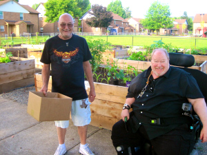 Jack & Robert after purchasing plant starts at the community plant sale.