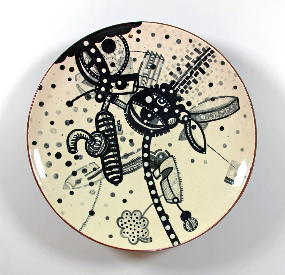 "J. Knight/ C. Skura  2011. Earthenware, hand-painted underglaze and clear glaze.  17"" in diameter x 4"" H.."