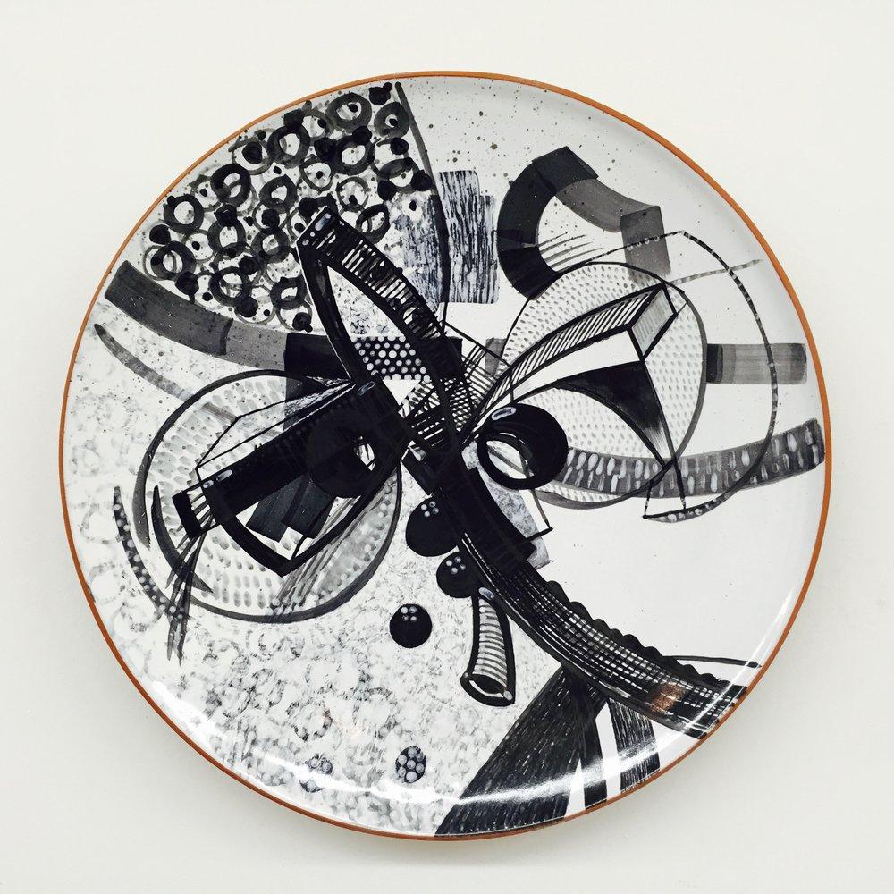 "J. Knight/ C. Skura  2015. Earthenware with hand-painted majolica.  13"" in diameter."