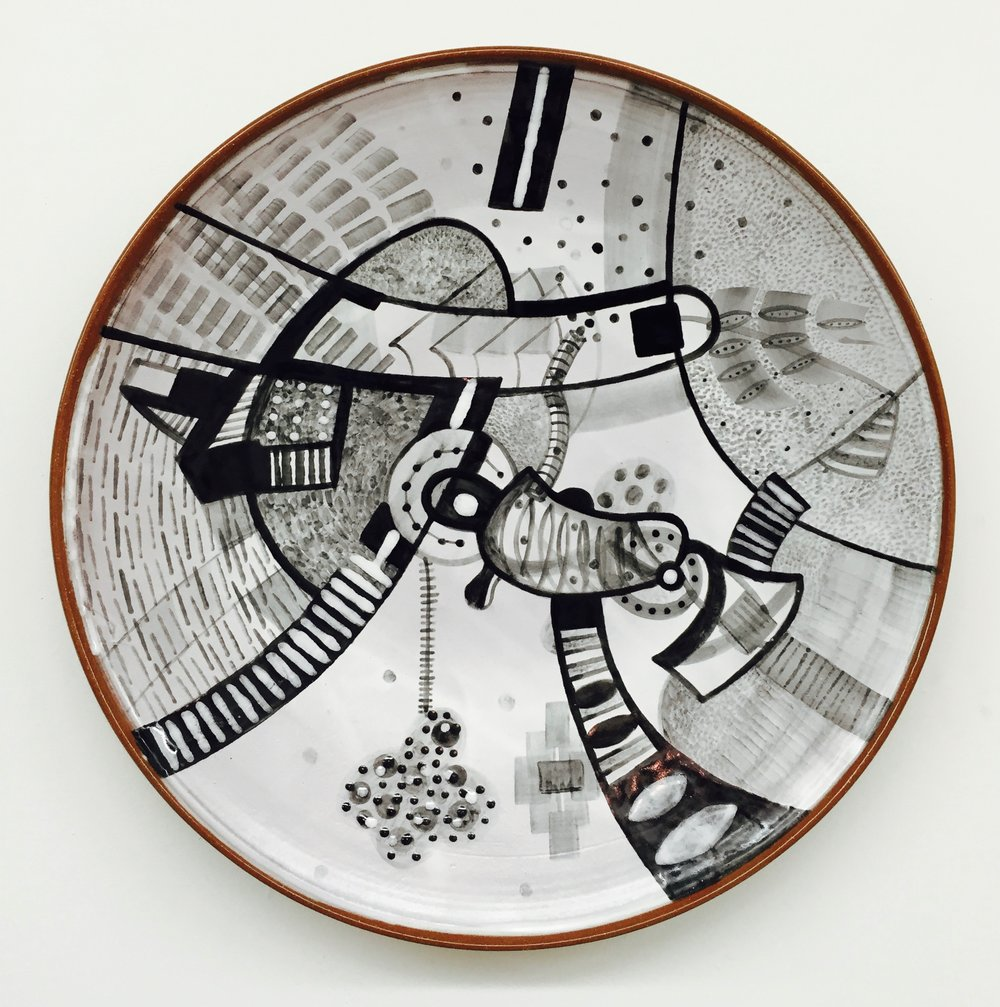 "J. Knight/ C. Skura  2010. Earthenware with hand-painted majolica.  18"" in diameter x 3"" H.."