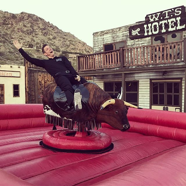 Our President @productionrob testing out the mechanical bull before the clients game night.  #workhardplayhard