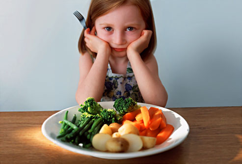 kid eating veggies.jpg