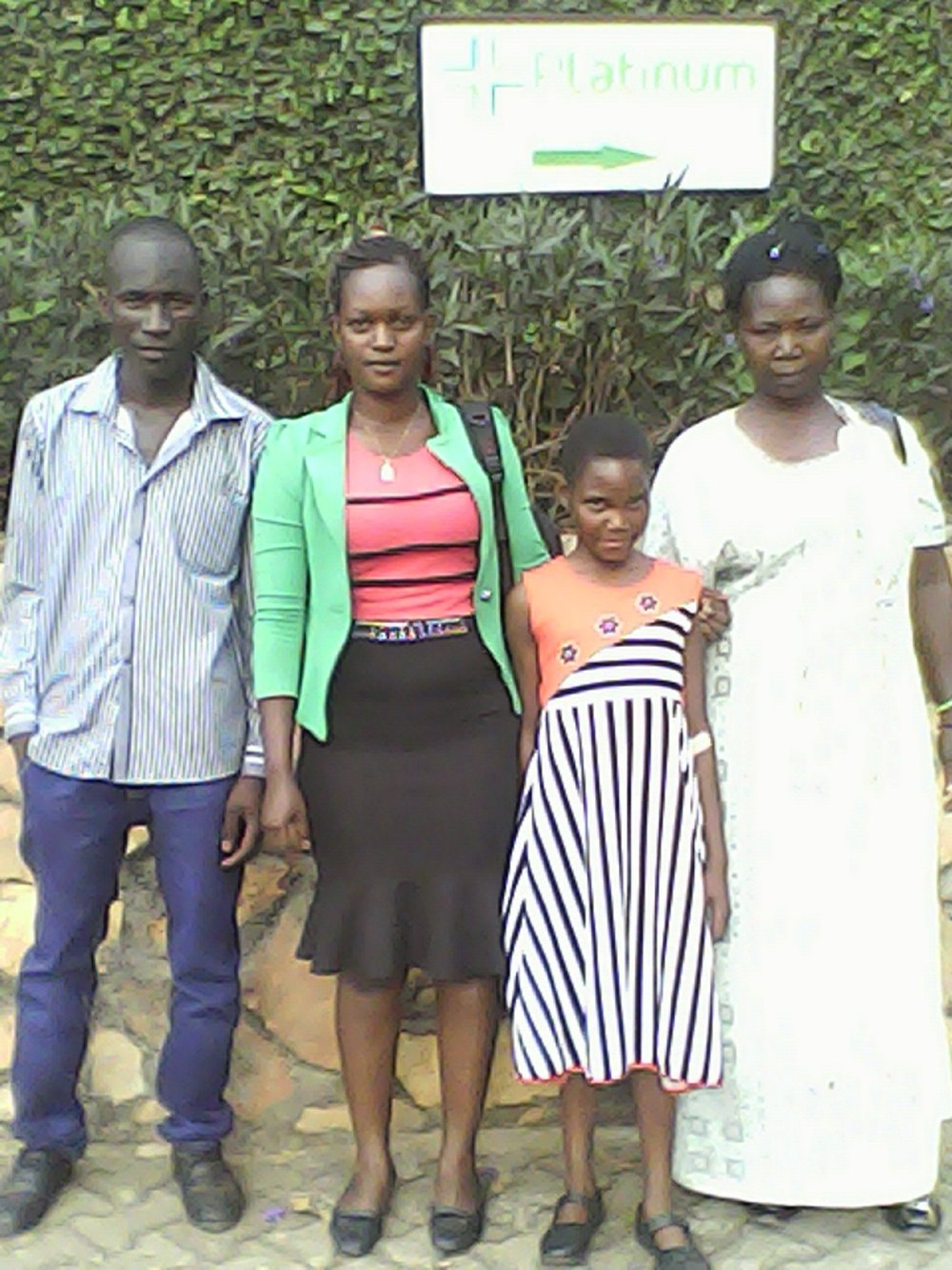 Left to Right: Posiano - a Tusubira beneficiary needing corrective surgery, Prossy - Tusubira alumni in nursing helping to lead this medical project, Daphne - a Tusubira scholarship recipient also needing corrective surgery, and Daphne's aunt.