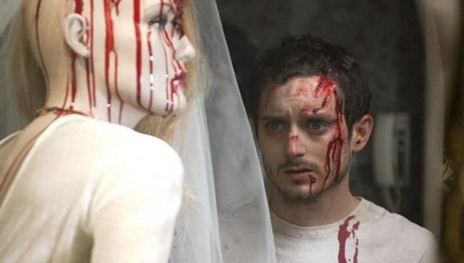 Elijah with bloody manequinne
