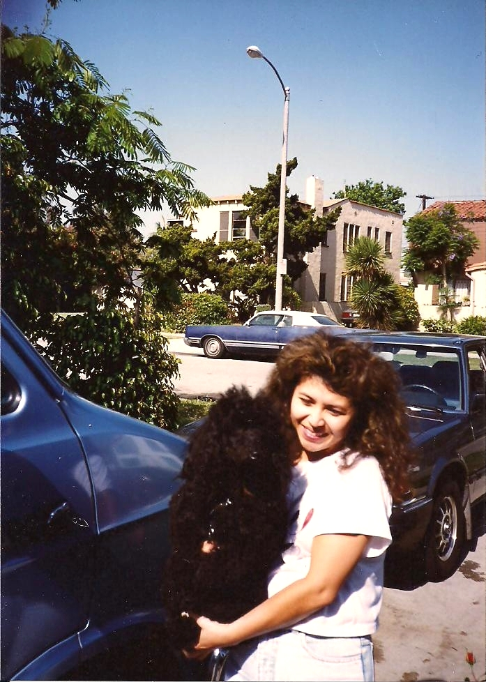Mabel in her early years, carrying a poodle to her van to be groomed.