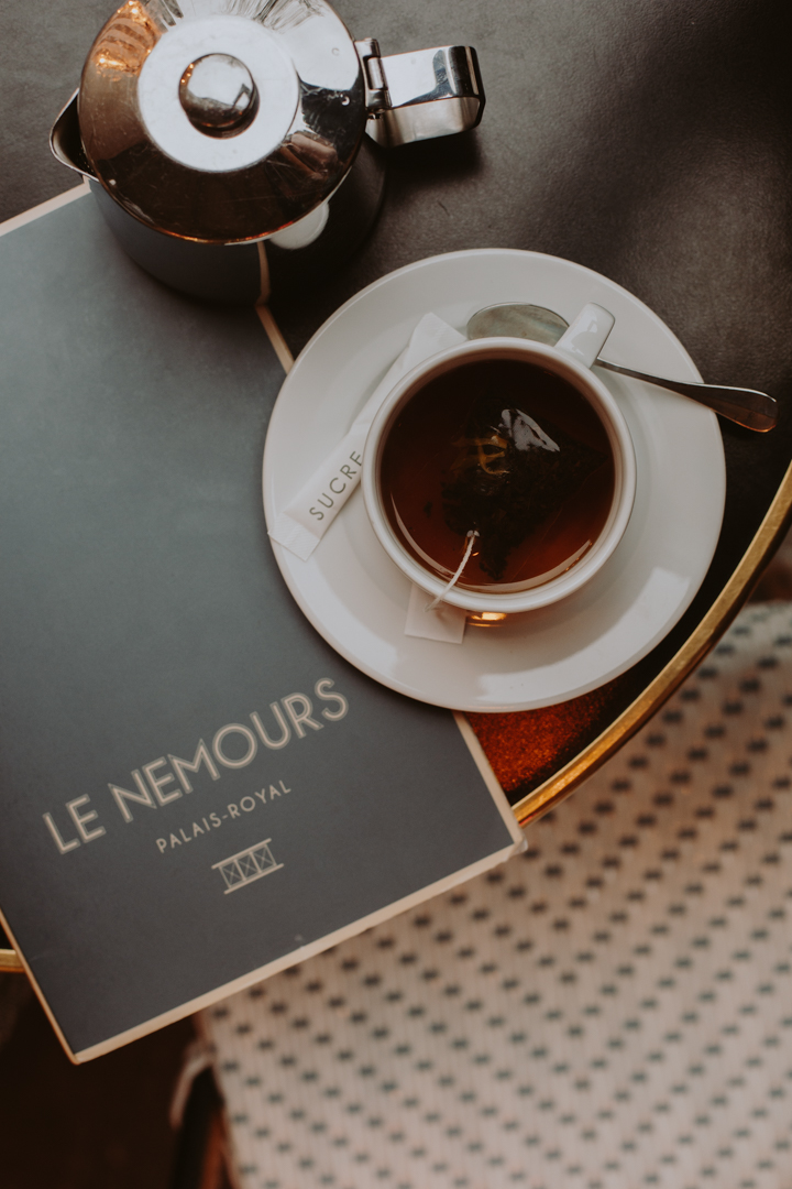 Café - Any trip to Paris requires a stop at a café to enjoy a cup of coffee or tea and people watch. Pick any café you see and spend an hour or two outside taking in the sites, sounds, and people — just like the Parisians do.