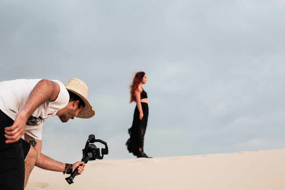 Director Richard Clifford, filming during one of the dune takes.