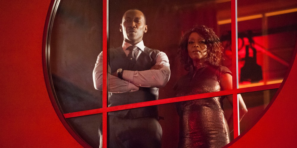 "Cornell ""Cottonmouth"" Stokes played by Mahershala Ali and Mariah Dillard played by Alfre Woodard overlook the club scene below."