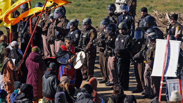 Standing Rock water protectors stand vigilant across from the militarized arm of the plutocratic establishment. History repeats itself as plutocracy, colonialism, white supremacy and injustice coalesce in America.