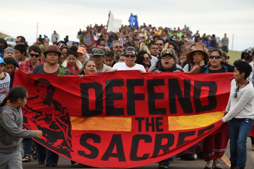 Members of the Standing Rock Sioux Tribe, and their supporters, march to stop the construction of the Dakota Access Pipeline.