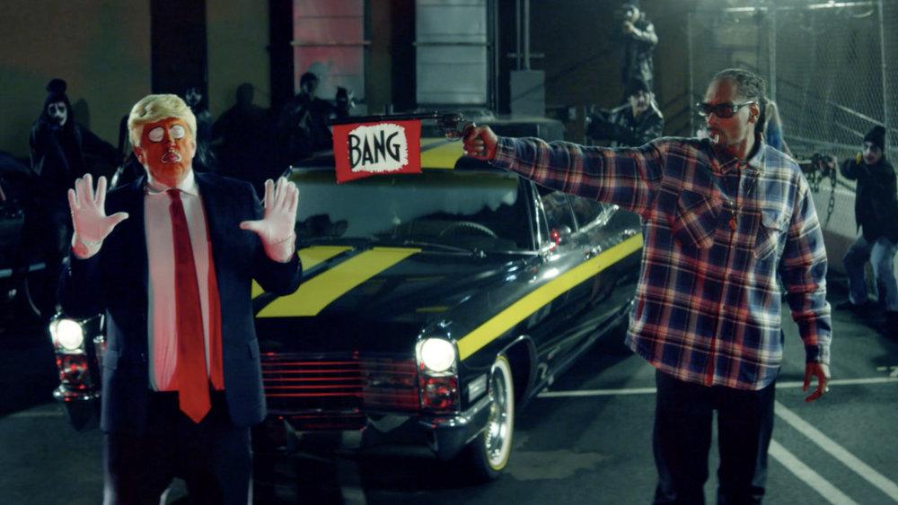 Snoop Dogg seen shooting a toy gun at a clown version of Donald Trump in 'BadBadNotGood' music video