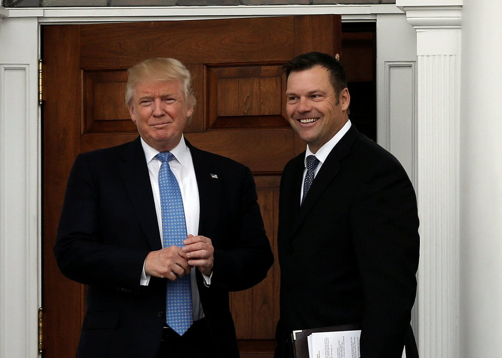 Donald Trump (left) with Kris Kobach (right)