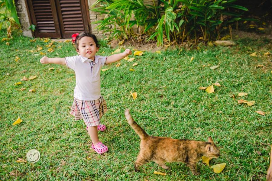 a girl and cat at bon ton resort langkawi