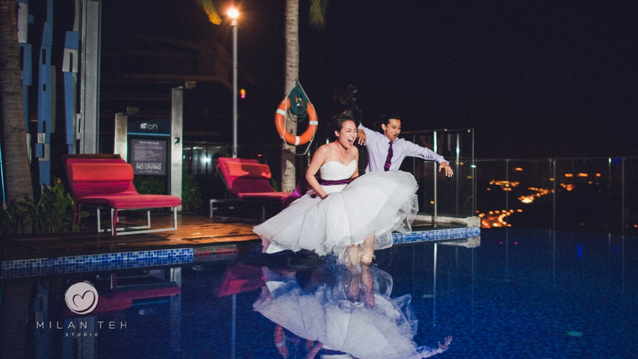 wedding couple jumping into the pool malaysia