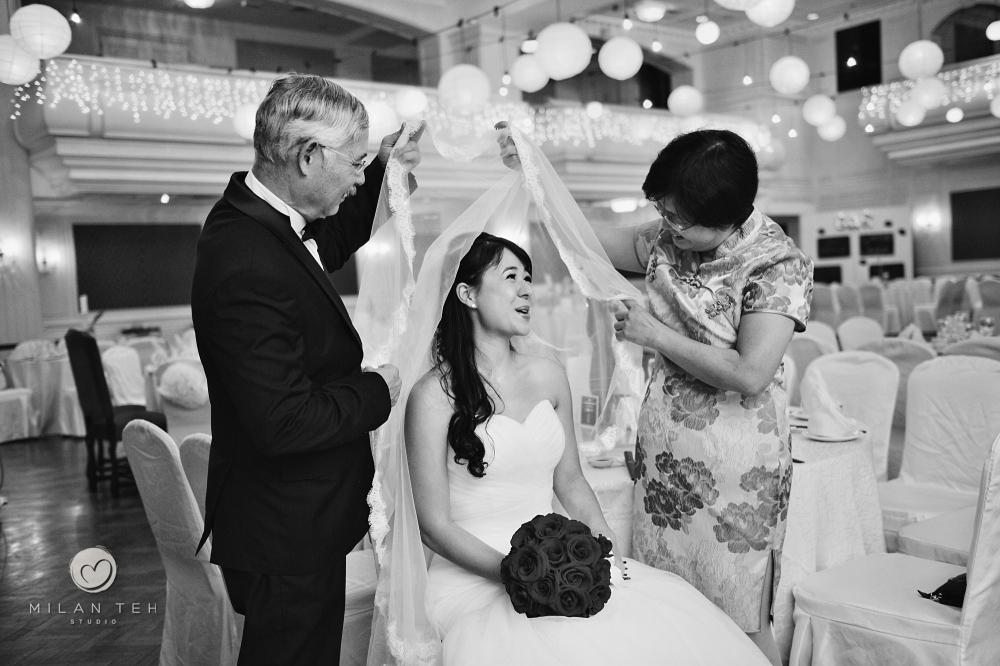 parents closing veil for bride at e&o hotel penang wedding