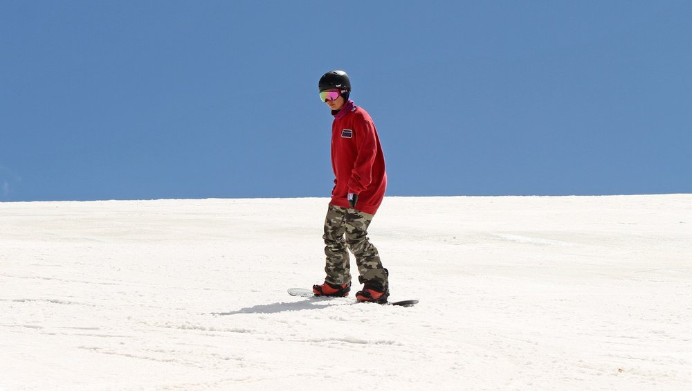 Maintain the flexed front knee as you drop down the slope