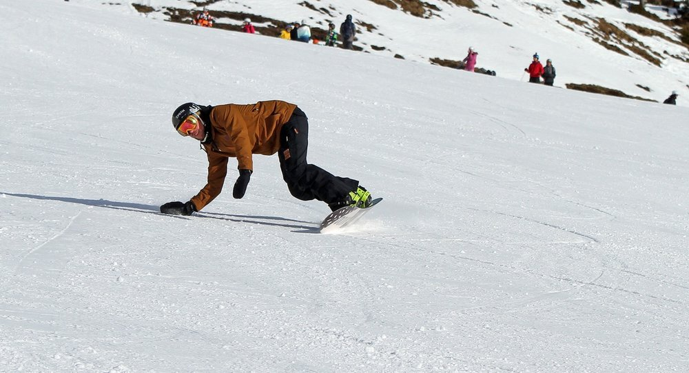 Work towards touching the snow on a toeside carve