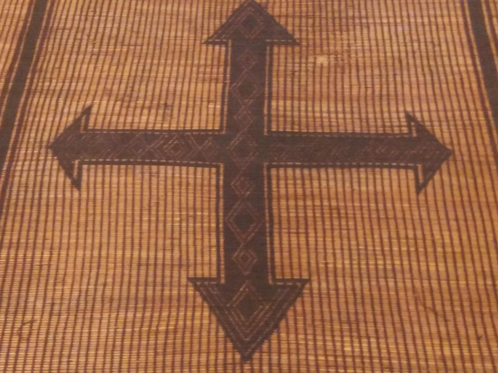 Tuareg leather and straw mat with cross - Moroccan Berber Carpets.jpg