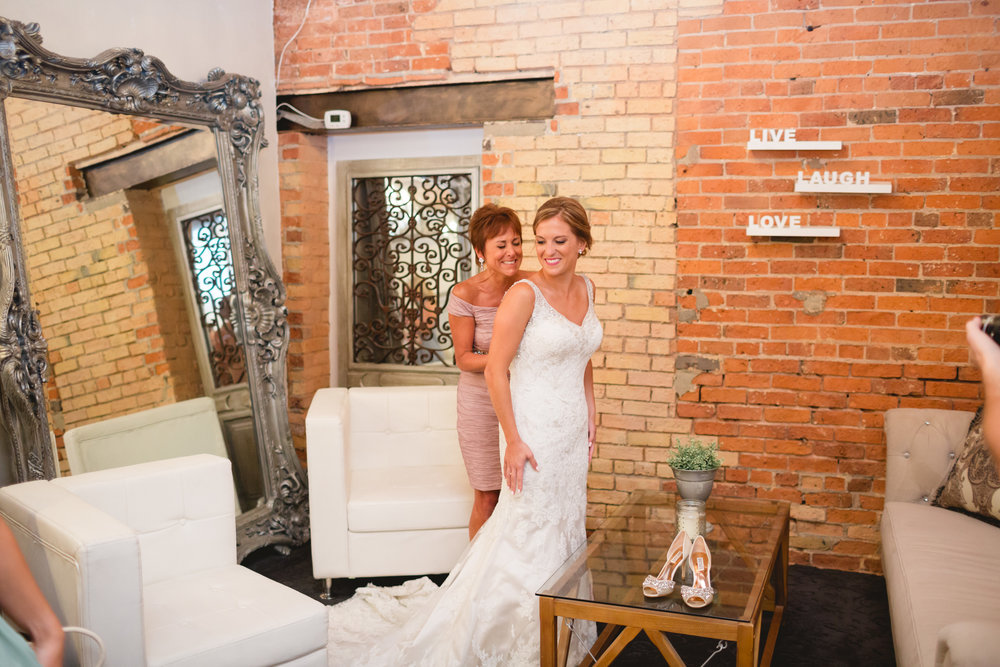 Bride Putting Dress On.jpg